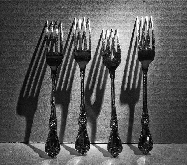 photo of forks with shadows