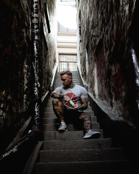 A candid portrait of a man sitting on steps
