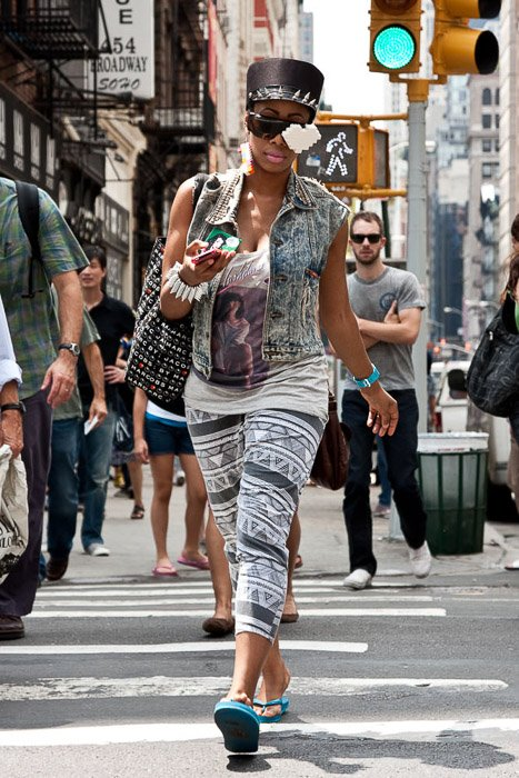 Candid street photo of a woman walking through a busy urban area