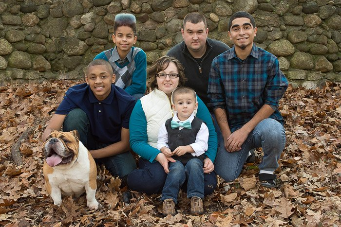 A family portrait of six people posing with the Family Pets