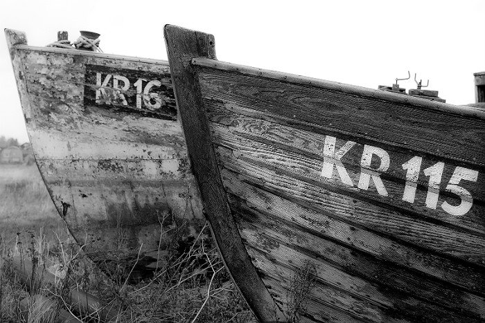 Black and white photo of weathered boats