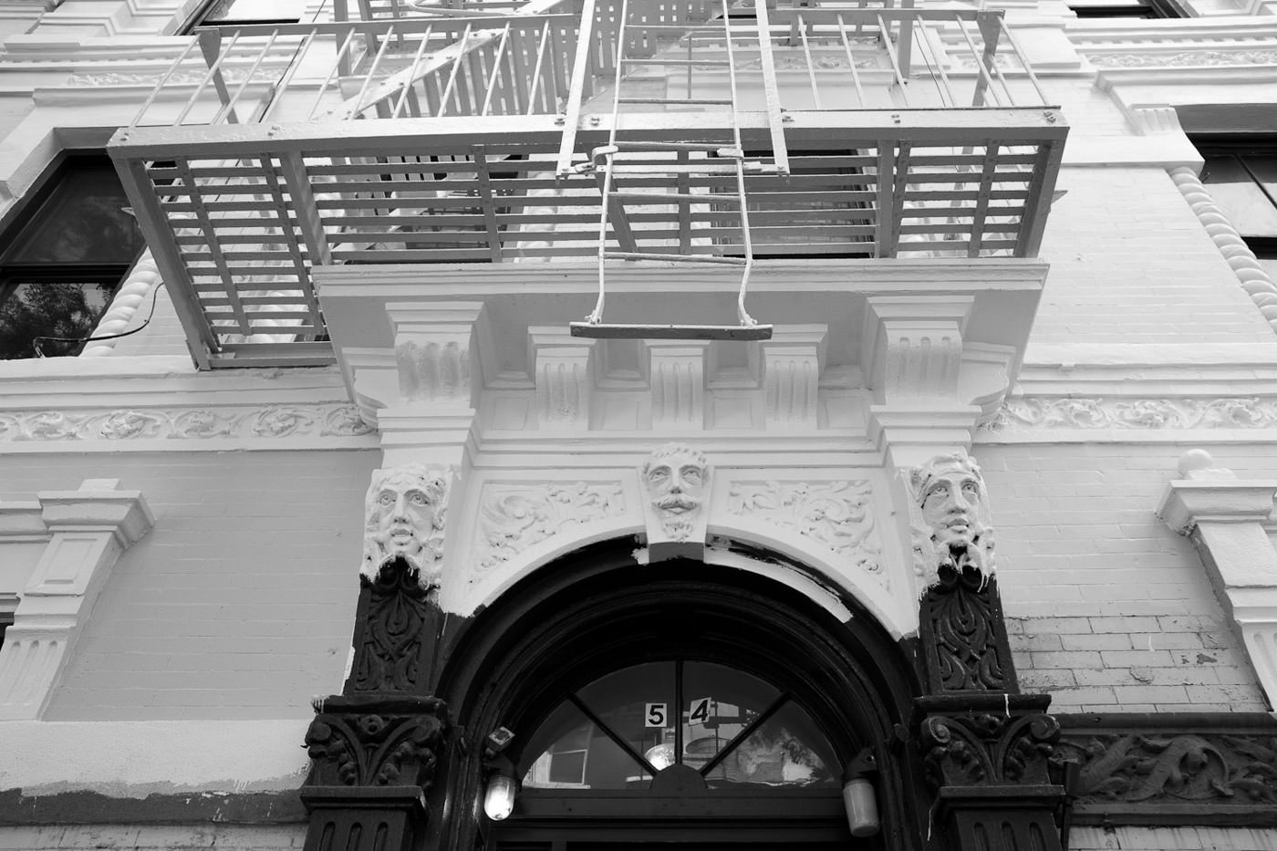 Street photography: Image of fire escape seen from below