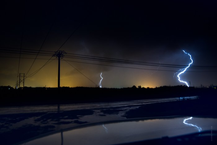 Dramatic Weather: Lightning strikes on the horizon during a thunderstorm