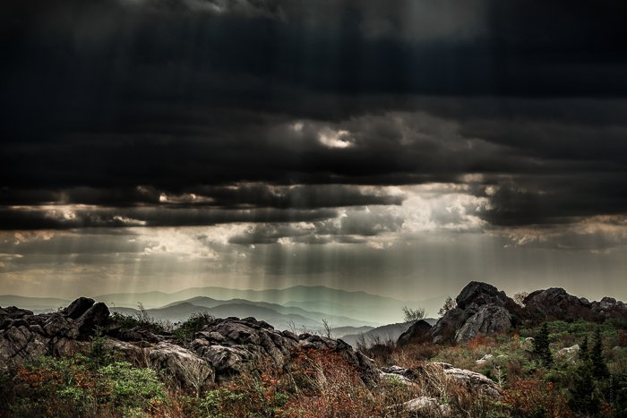 Dramatic Weather: Shafts of light coming down on hills through heavy cloud cover
