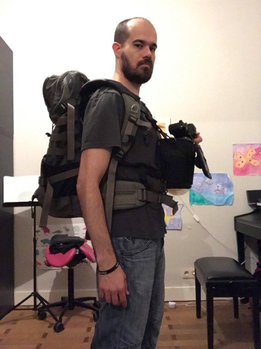 Landscape photography gear: The author carrying his landscape photography gear (packs, camera, and harnesses)