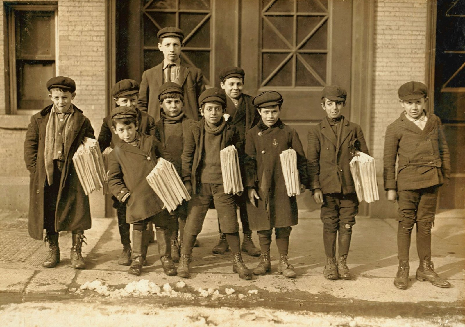 Early 20th century sepia photo of newsboys in Connecticut