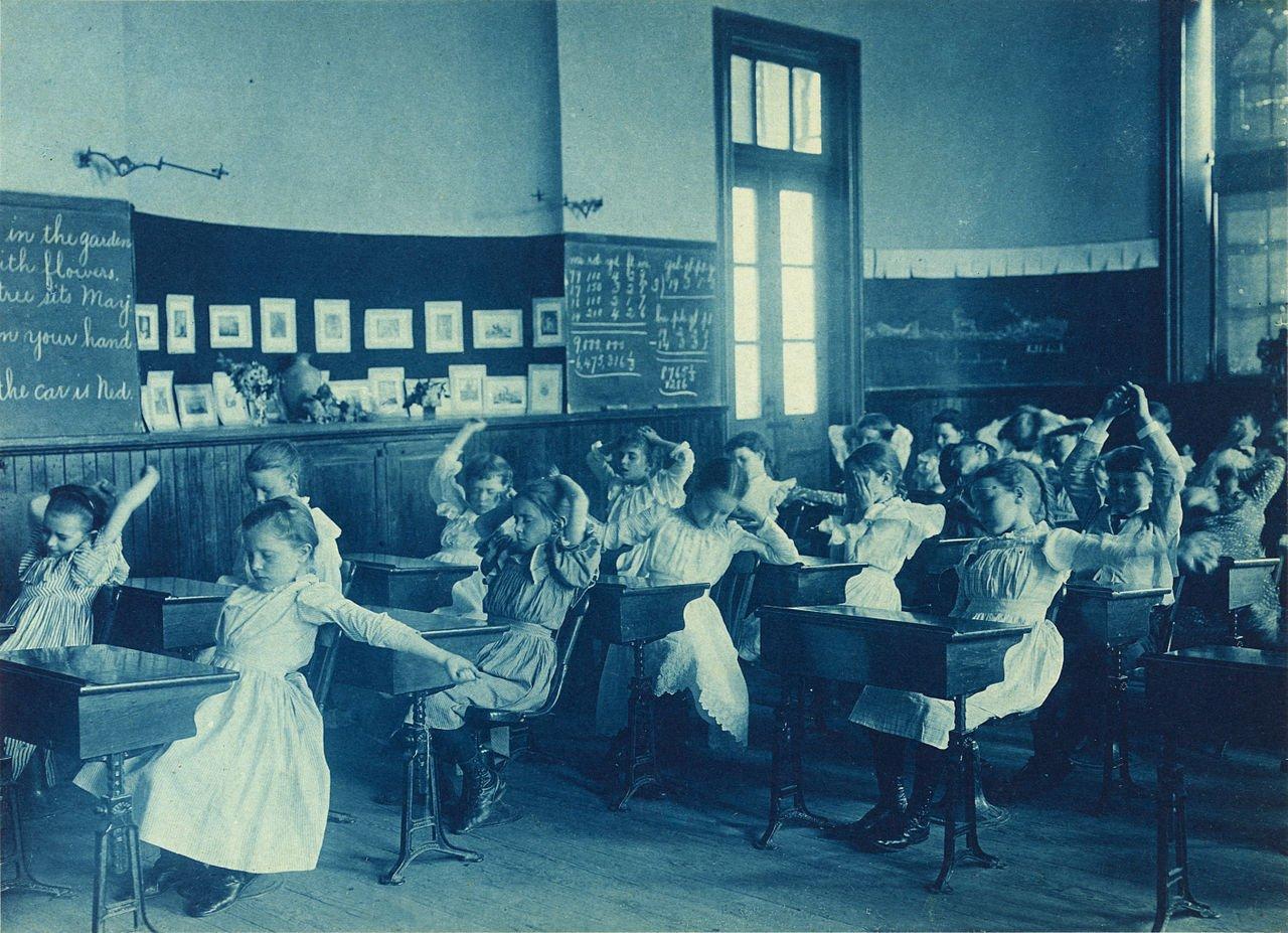 Late 19th century cyanotype photo of schoolgirls doing calisthenics