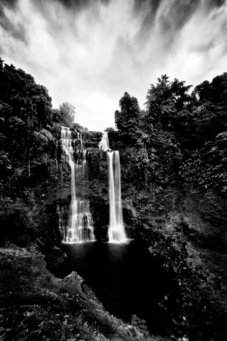 Long exposure black and white shot of a waterfall, portrait view