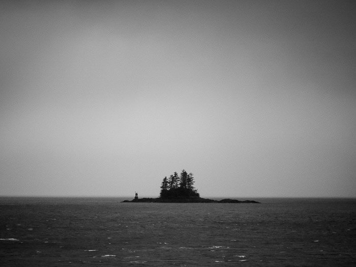Coastal photography: black and white image of small island in the near distance