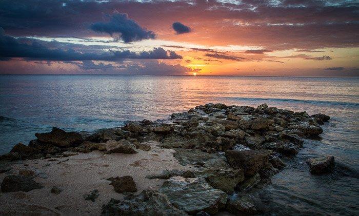 A stunning coastal photography shot of rocky jetty at dusk