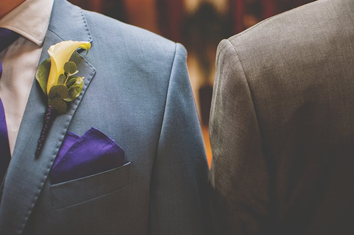 Photographing wedding details: Image of buttonhole flower affixed to lapel