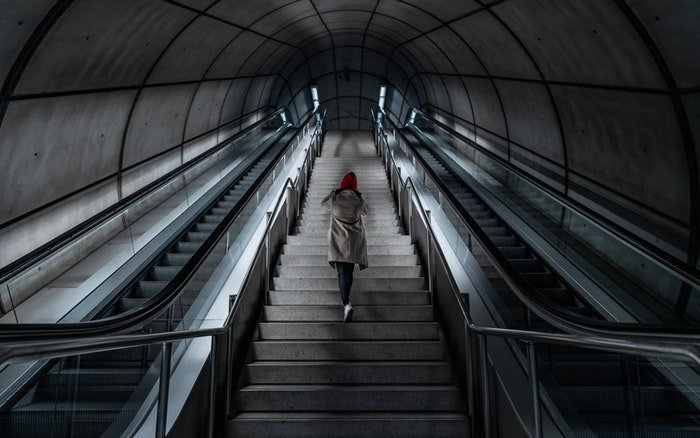 Person climbing stairs in a metro station