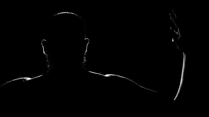 A low key portrait of a man using a rim light for portrait photography