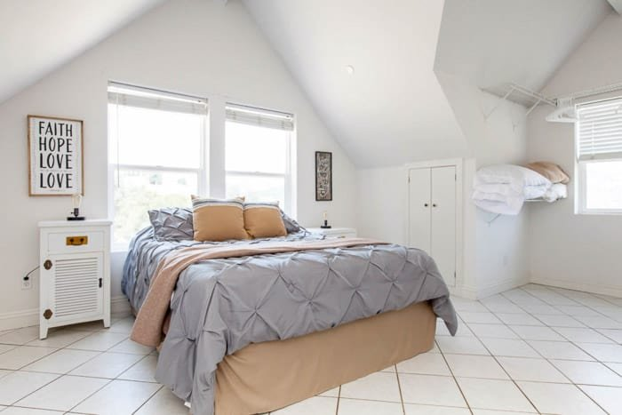 Bright and airy real estate photography of a bedroom with light balanced using bounce flash
