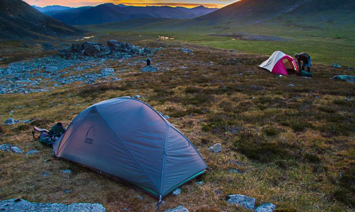 Landscape photography with a tent in the foreground and another in the background