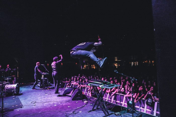 Photograph of William Control from backstage. High-speed photography caught the artist mid-jump.
