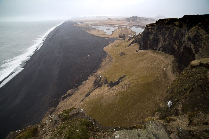 Landscape photograph shot from above of Black Sand Beach in Iceland
