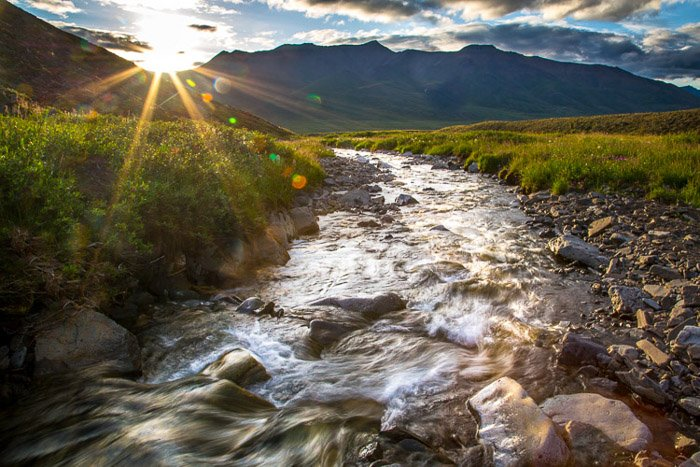 River landscape with perfect exposure. Soft water and sun-rays in image.