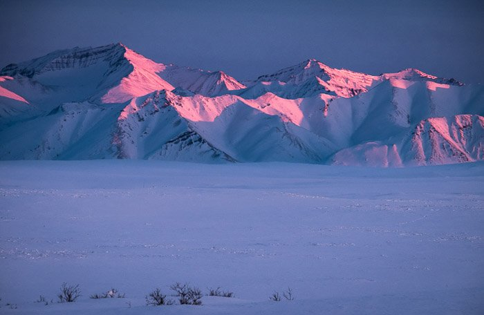 Mountains lit by beautiful sunset light demonstrating the impact of exposure.