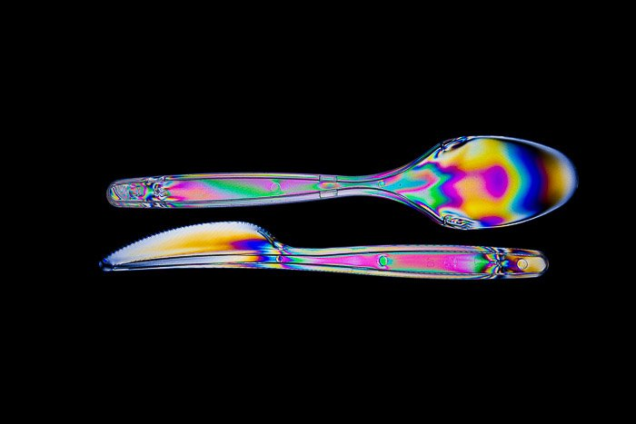 Rainbow effects passing through plastic cutlery with photoelasticity.