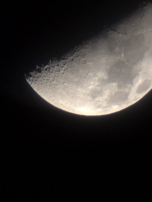 Unedited moon photography close up capturedwith iPhone 5 on a telescope