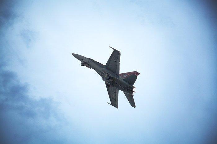 Fighter Jet mid-flight under-view