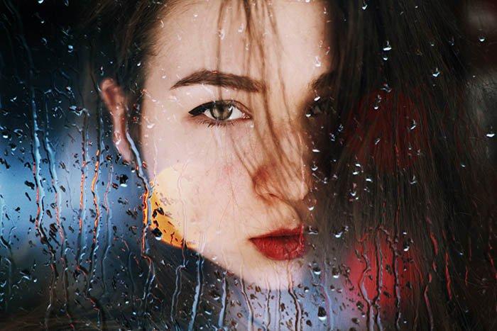 double-exposure image of Taya Ivanova's self portrait and raindrops
