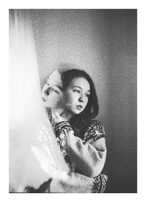 Double-exposure image blending two pictures of the same female model