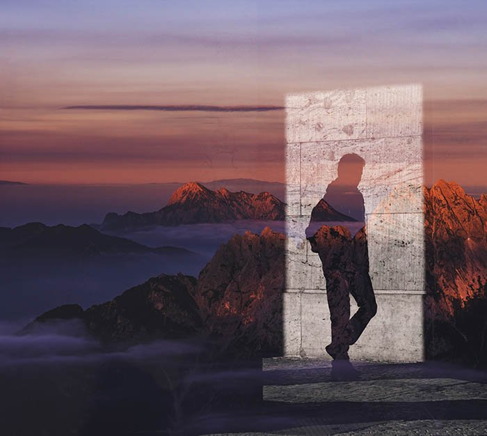 Two images combined in one, using a male shadow and a mountain landscape