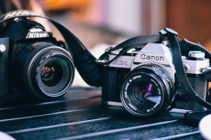 Photo of two DSLR cameras