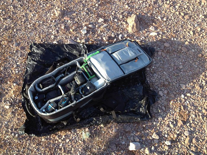 photo of using a garbage bag to protect your camera during desert photography