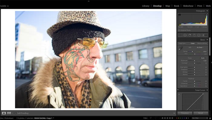 editing street photography - original photo of an old with a colourful face tattoo and eccentric clothes