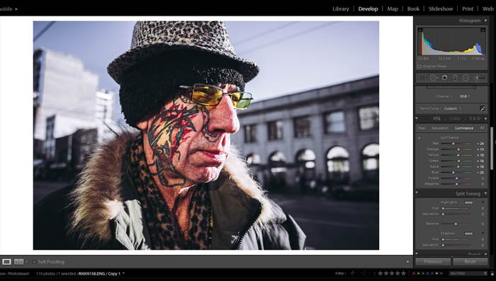 editing street photography - hue, saturation and luminance - picture of an old man with an interesting face tattoo and colourful glasses
