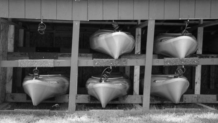 Broken pattern made up of six boats where the upper left one is missing