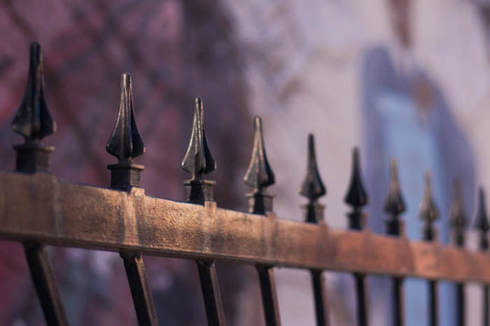 Picture of patterns in photography, showing the iron spikes of a fence