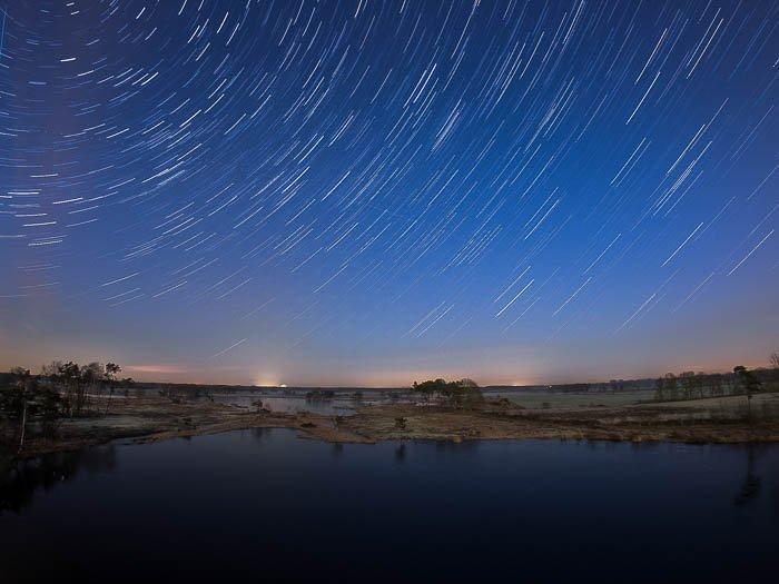star trail over Belgian marsh field