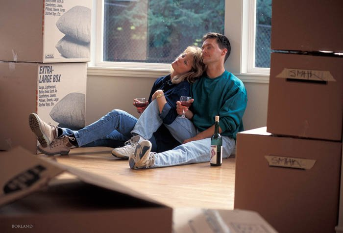 a couple moving to a new house and having rest with vine