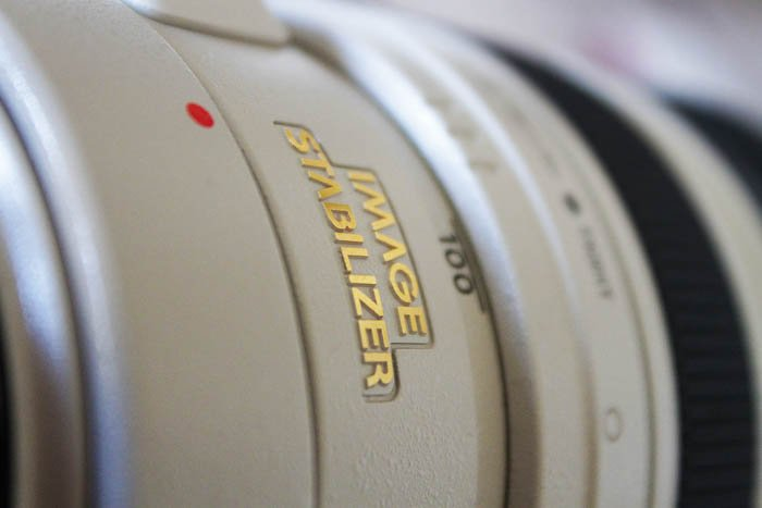 close up of the image stabiliser text on a lens