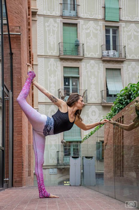 Urban yoga photography of a female model performing dancer's pose