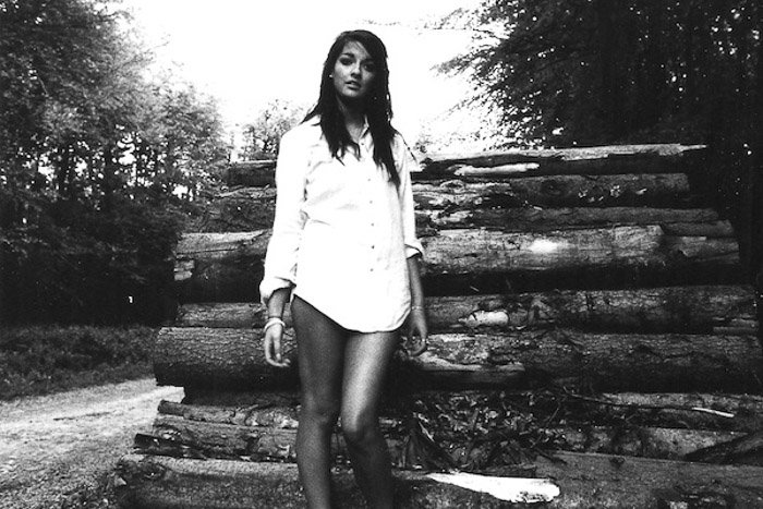 Atmospheric portrait of a female model shot with black and white film