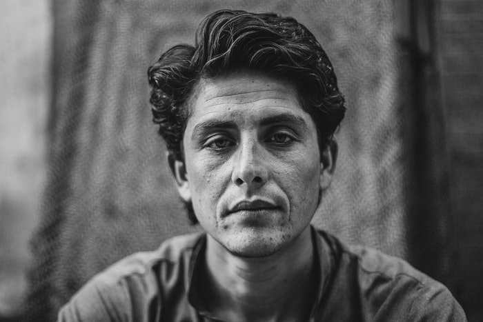 Black and white portrait of a man looking straight at the camera
