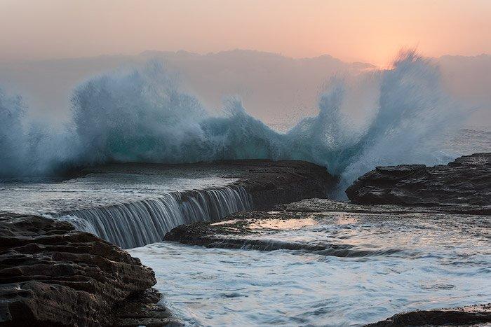 Seascape Photography of crashing waves over rocks