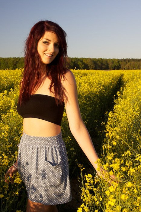 A portrait of a girl posing in a cornfield on a clear day - composition lines photography
