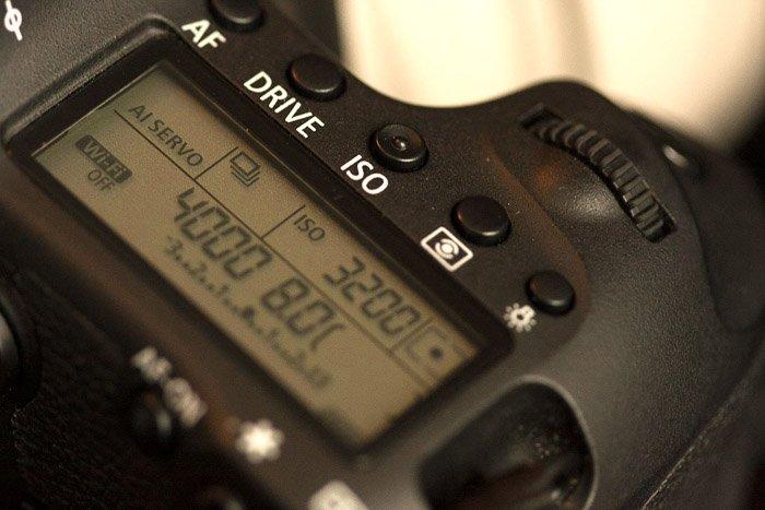A close up of adjusting camera settings