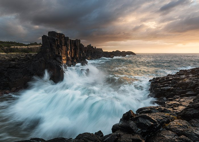 Dramatic seascape photography of rushing wave s at a rocky coast