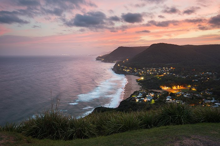 Aerial seascape Photography of a coastal town at sunset
