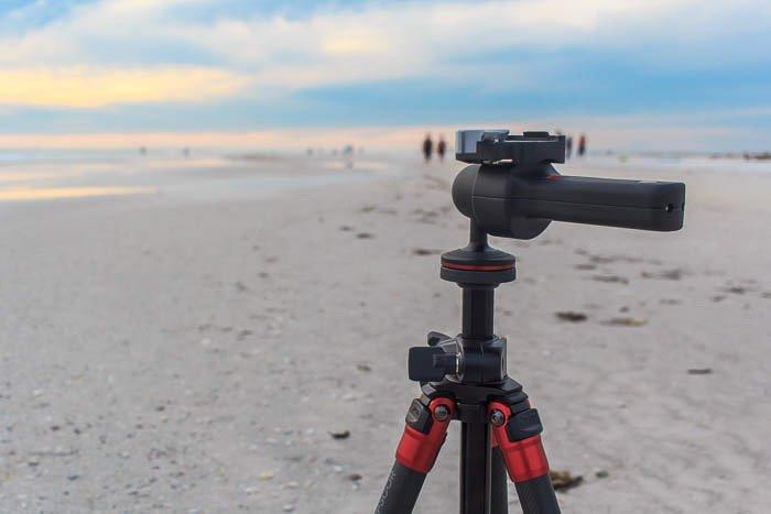 A tripod set up on a beach