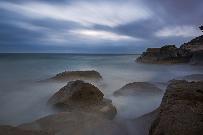 ultra long exposure of a misty rocky coast