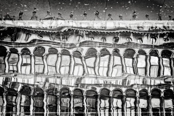 Abstract architectural photography reflection shot in a puddle