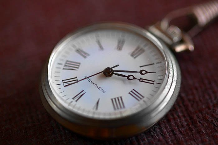 up close product photography of a wristwatch on an old style suitcase